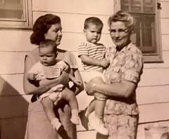Gloria holding Jolinda and Gladys holding Monte.