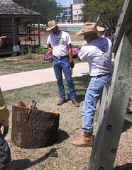 Men shearing and splitting  logs