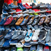 New Delhi, India - November 17, 2019: Mens knock off designer shoes for sale in Nehru Place. This market is filled with electronic goods, cell phone accessories and clothing