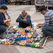 New Delhi, India - November 17, 2019: Vendor offers pliers, wrenches, scissors, screwdrivers and other tools on a blanket at Nehru Place market