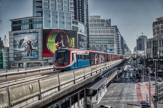 BTS Skytrain arriving at Asoke station on Sukhumvit road in Bangkok, Thailand