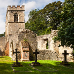 Headstones and the old church, Ayot St Lawrence by Iain Houston