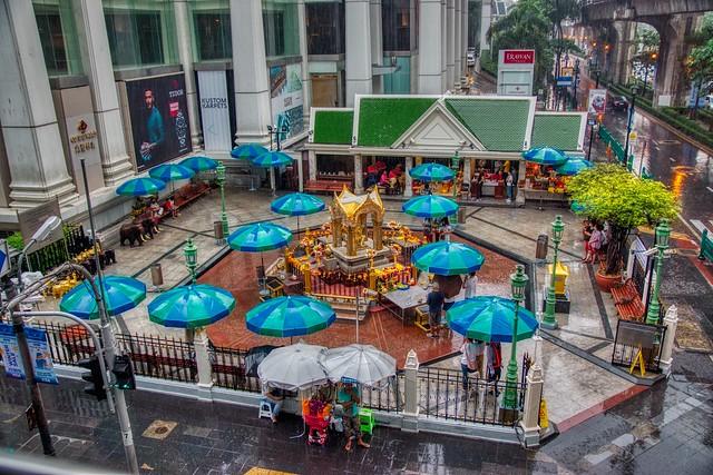 Erawan Shrine in the rain on Ratchadamri road in Bangkok, Thailand