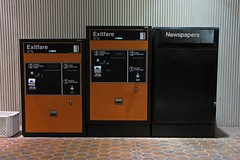 Exitfare machine and newspapers box at Largo Town Center