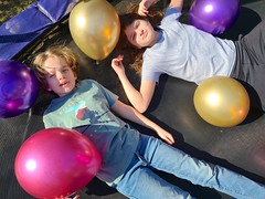Everett And Grace On The Trampoline With Balloons