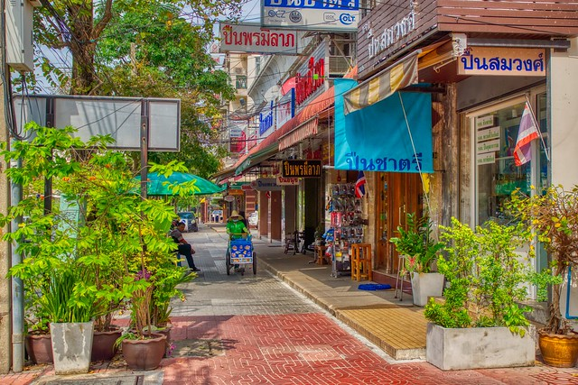 Street with shops on Rattanakosin island (old town) in Bangkok, Thailand