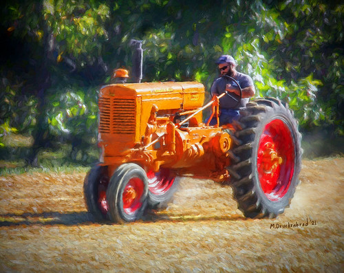 Bright Orange Minneapolis-Moline Tractor making dust at Two Top Ruritan Club in Mercersburg PA