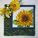 """Quilted Trivet (1)  $18  Sunflower with Abstract Paisley Border.  9"""" square.  Click here for more info"""