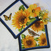 "Quilted Trivets (2) Set #3  $25  Sunflowers with Monarch butterfly and bird.  7.5"" square.  Click here for more info."