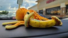 Woomy holds a banana