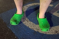 Standing in green Crocs