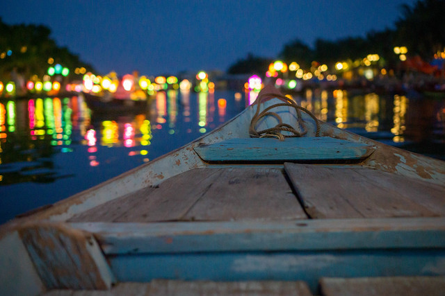 Photo:Night Photo from a Wooden Tourist Boat with Bright Lights reflecting in Thu Bon River in Hoi An, Vietnam By wuestenigel