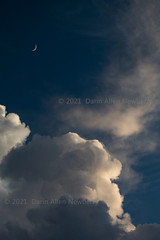 Sunlit Clouds and Moon
