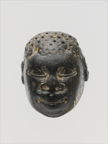 Cypriot chlorite pendant in the form of a human head (Met 74.51.5010)