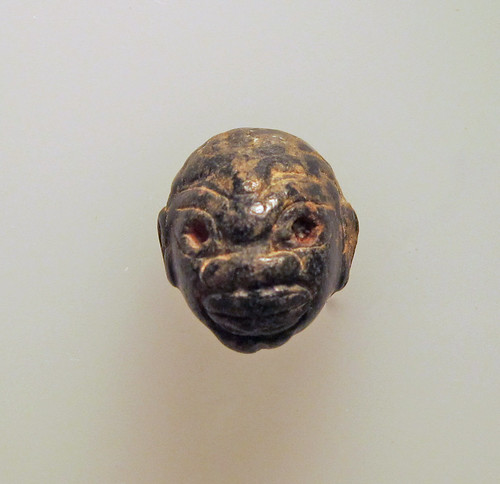 Cypriot chlorite pendant in the form of a human head (Met 74.51.3161)