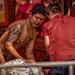 New Year's 2018 Bangkok, Thailand on Yaowarat Rd: beautifully tattooed man. 631a