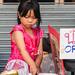 New Year's 2018 Bangkok, Thailand on Yaowarat Rd: cute girl practicing cutting into Styrofoam.  653a