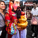 New Year's 2018 Bangkok, Thailand on Yaowarat Rd: a young woman getting photo with a colorful character (perhaps a rich businessman). 674ac