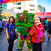 New Year's 2018 Bangkok, Thailand on Yaowarat Rd: woman pose with a green dragon and a big-head character.  678a copy