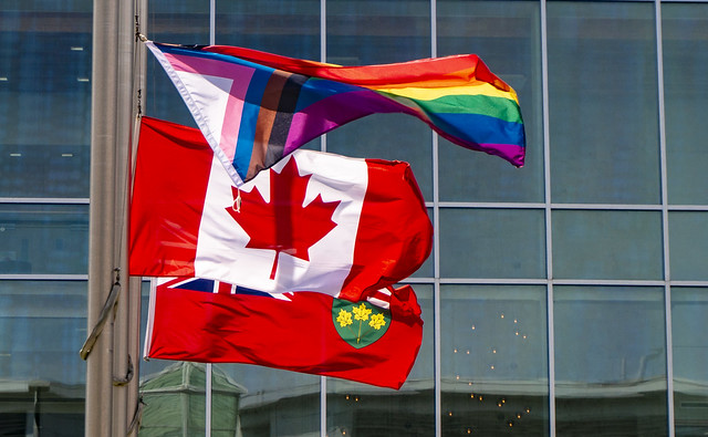 Photo:Modern lines. Buildings around the hospitals area pertaining to Riverside Park neighborhood. The Ottawa Hospital General Campus (TOH GEN) - LGBT, CAN and ONtario flags outside the Cancer Centre Entrance By lezumbalaberenjena