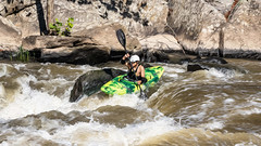Kayaker navigating the plunge into the