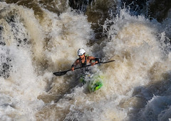 Kayaker plunge into the