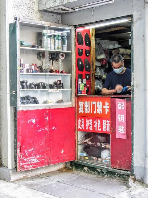 A shoe repair shop on the street corner
