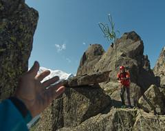 Catch! Rigging the Tyrolean traverse on the Clochers Clocheton traverse, Chamonix. Climber: Alan Scowcroft