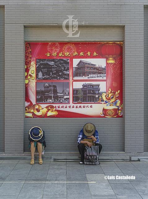 Tired visitors at Qianmen Street. Beijing. China