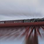 The Flying Scotsman crossing the Forth Bridge by JOHN REDDINGTON
