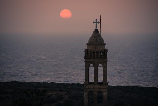 hazy sunset beyond the monastery