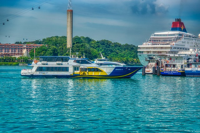 Harbor with ferry boats and cruise ships in Singapore