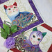 """Quilted Trivets (2) Set #2 $30  Paisley Jewel Tone Cats on Cream with Border  10.5"""" square.  Click here for more info"""