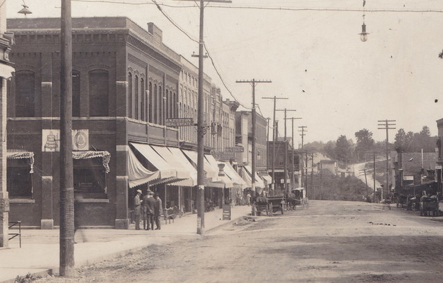 Photo:CEN Hart Oceana MI RPPC North View of State St. Downtown Stores and Businesses WOod Boardwalk Sidewalks Dirt Streets Horse and Buggy Days NOT AN AUTOMOBILE IN SIGHT 1-1 By UpNorth Memories - Don Harrison