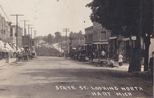 Photo:CEN Hart Oceana MI RPPC North View of State St. Downtown Stores and Businesses WOod Boardwalk Sidewalks Dirt Streets Horse and Buggy Days NOT AN AUTOMOBILE IN SIGHT 1-2 By UpNorth Memories - Don Harrison