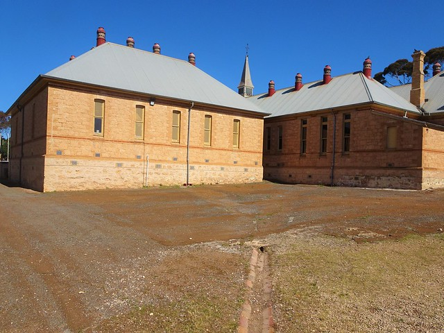 Photo:Moonta Mines. The stone Moonta Mines School was built in 1878 and added to several times. It is now the Moonta Mines Museum.  This was a copper mining town from 1861. By denisbin