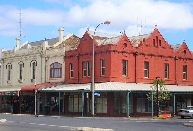 Photo:Port Pirie. Old turn of the 20th century shops and stores in Ellen Street. The Gothis style shops on the corner as known as the Federal  Building built just after Australian Federation in 1901. By denisbin