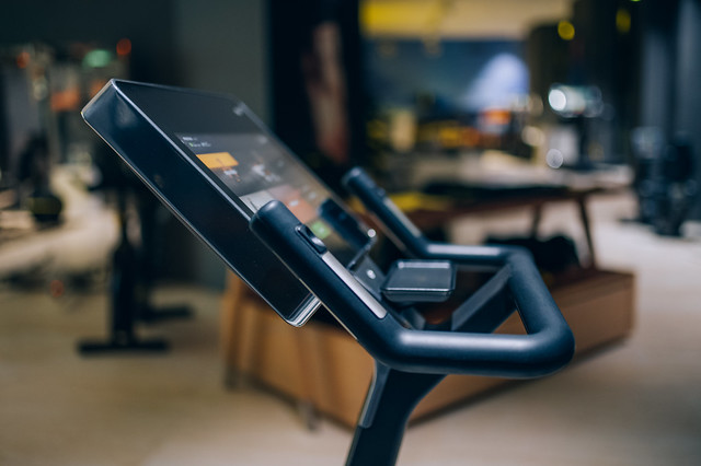 Screen and handles of a stationary bicycle at a gym