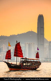 Hong Kong - Junk in Victoria Harbour and City Skyline at Sunset Time